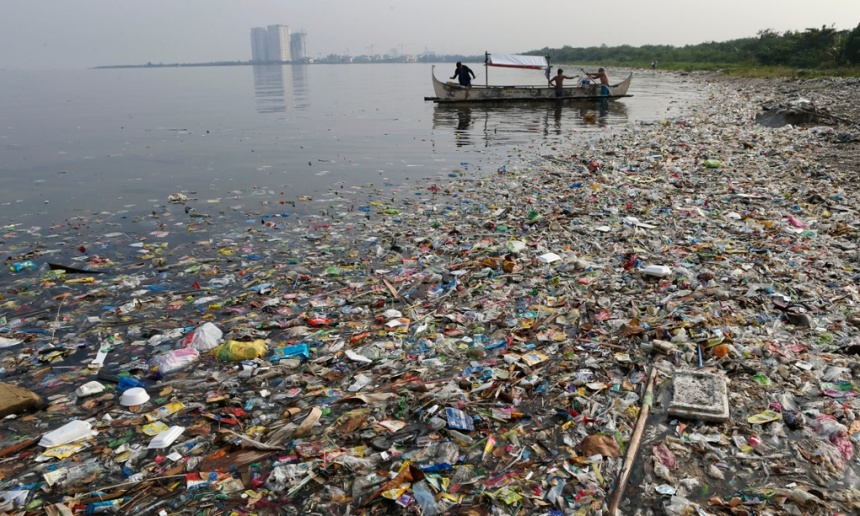 Fishermen prepare to fish, amidst floating garbage off the shore of Manila Bay during World Oceans Day in Paranaque, Metro Manila in 2013. Photograph: ERIK DE CASTRO/REUTERS