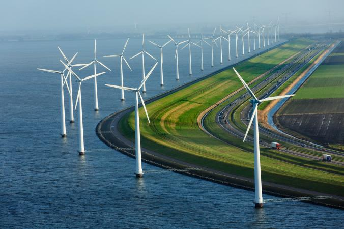 Flanked by windmills, this dike protects farmland that is almost entirely below sea level in Flevoland, the Netherlands. Photograph by George Steinmetz, National Geographic