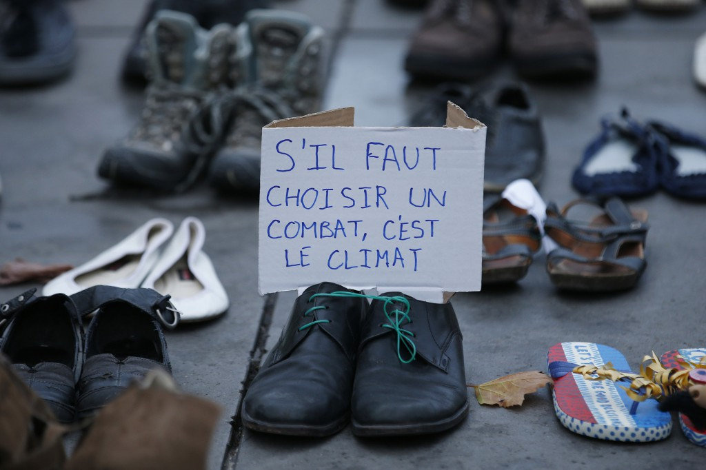 Would-be marchers left shoes on the ground in Paris after the planned march was called off amid heightened national security. Reuters/Eric Gaillard