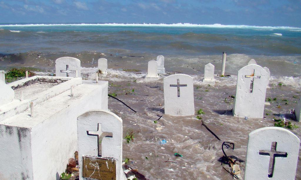A cemetery on the shoreline of Majuro, the capital of the Marshall Islands, is flooded from high tides and ocean surges. Some countries in the Pacific Islands Forum Secretariat – a political grouping of 16 independent and self-governing states – lie barely a metre above sea level and fear they will disappear beneath the waves without drastic intervention. Photograph: Giff Johnson/AFP/Getty Images