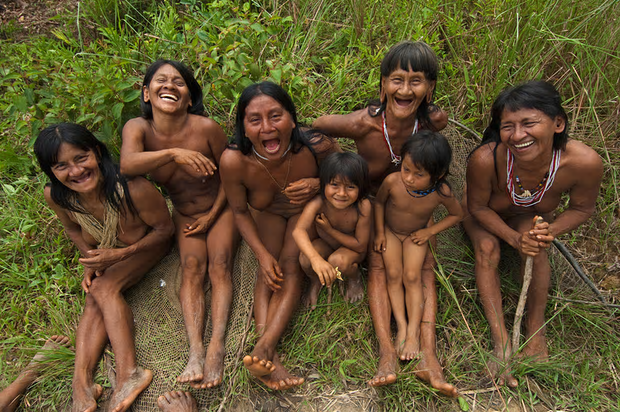 Laughing Hauorani women and children sitting in the forest in the Bameno Community Ecuador's Yasuni National Park. Conservationists are belatedly recognising that indigenous people may be the world's strongest defense against deforestation and biodiversity loss, yet most indigenous people still lack rights to their customary lands.