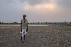 Because of the drought, Karori, 60, from Achanwara in India, has lost the crop that would have provided the annual income to feed his family. 'I can only pray to God now for the rains to come so our hardships may be lifted,' he says. Photograph: Tiatemjen Jamir/World Vision