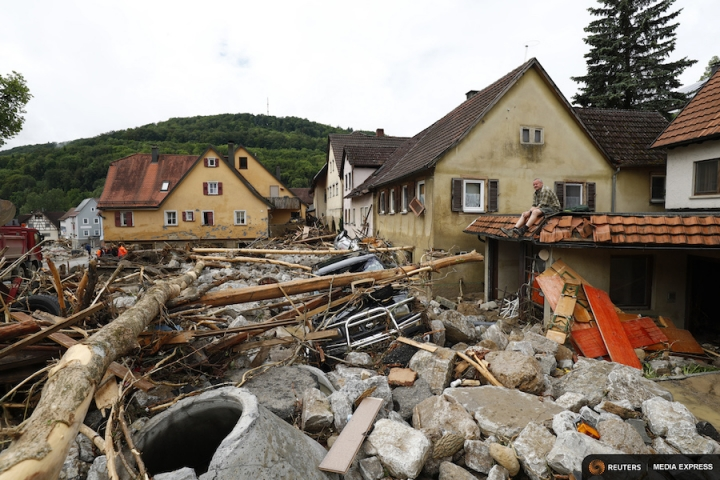 A man looks at the damage caused by the floods in the town of Braunsbach in Baden-Wuerttemberg, Germany, on May 30, 2016. Credit: REUTERS/Kai Pfaffenbach