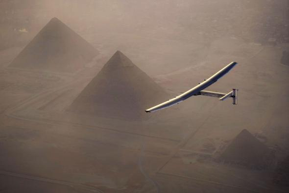 The Solar Impulse 2 flies around Egypt's pyramids shortly before completing the final leg of its trip around the world. Photograph by Jean Revillard, Solar Impulse2/Getty