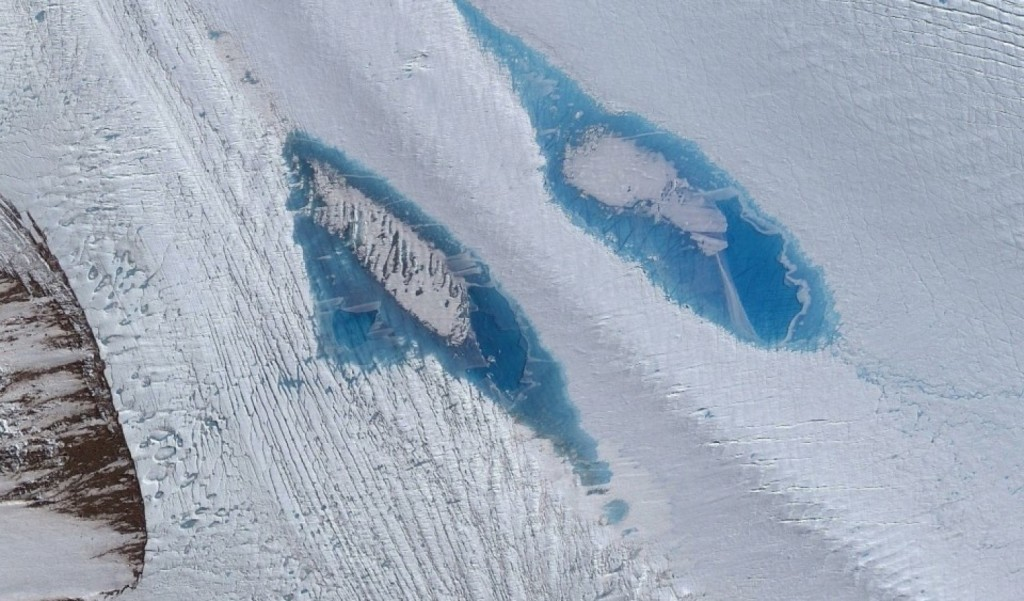 HANDOUT PHOTO: Satellite image shows a group of lakes atop Langhovde Glacier, East Antarctica. (Satellite image courtesy of DigitalGlobe, Inc.)