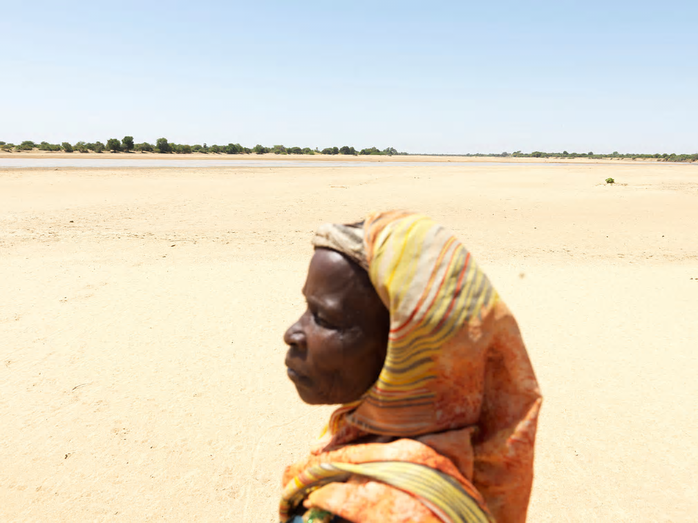 Drought in the Sahel region of Africa has brought hunger to millions of people for the third time in seven years. In Chad, Abdoulaye Katir searches for clean water on a river bed near Hillé Bar village, Dabkere, near Oum Hadjer. The village's crops are ruined and the community faces hunger.