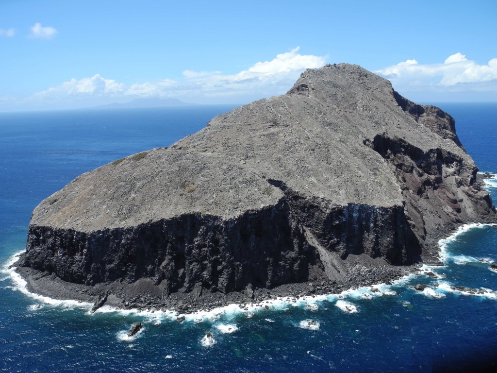 Redonda from the air. The island, once forested, now looks like a lunar landscape. Photo by Jenny Daltry/Fauna & Flora International.