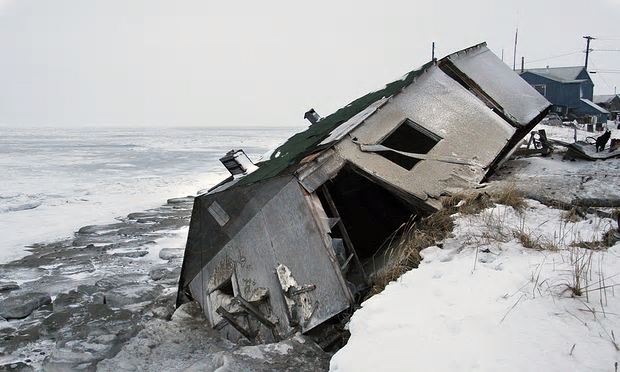 An abandoned house in Shishmaref, Alaska sits on the beach after sliding off during a storm in 2005. Photograph: Diana Haecker/AP