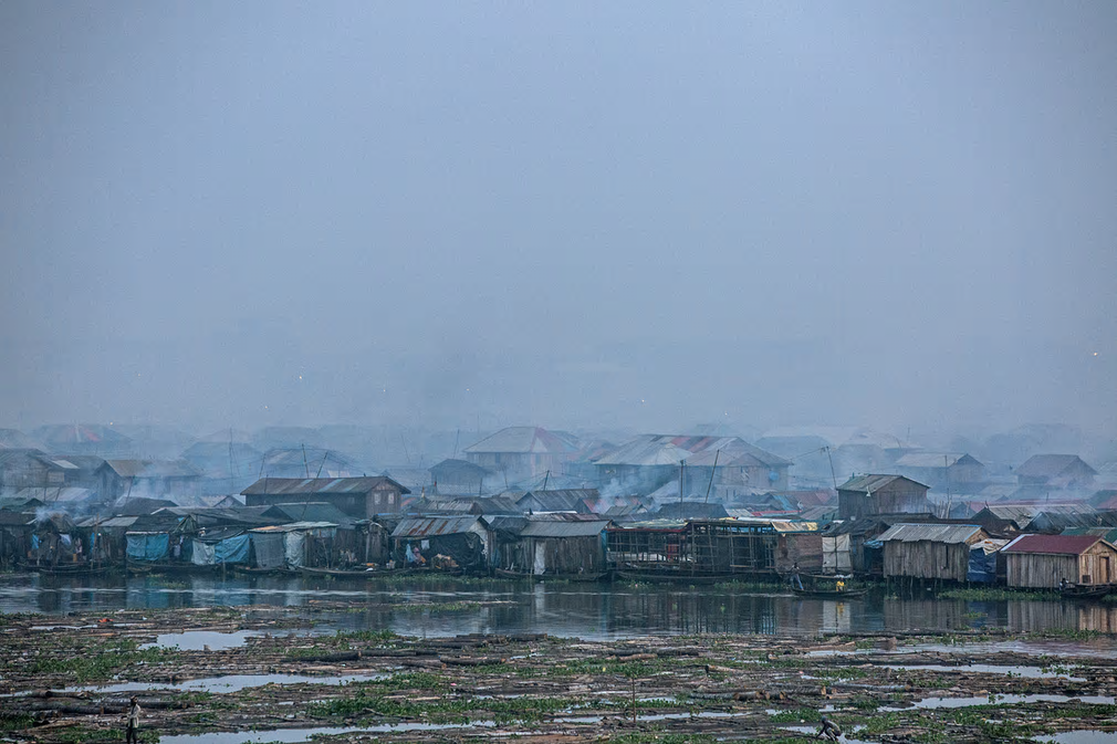Lagos, Nigeria. Smog covers Makoko, a fishing community mostly made up of structures on stilts. Vehicle emissions, diesel generators, burning of biomass and garbage and other environmental waste greatly affect the community's water and air quality. Photograph: UNICEF