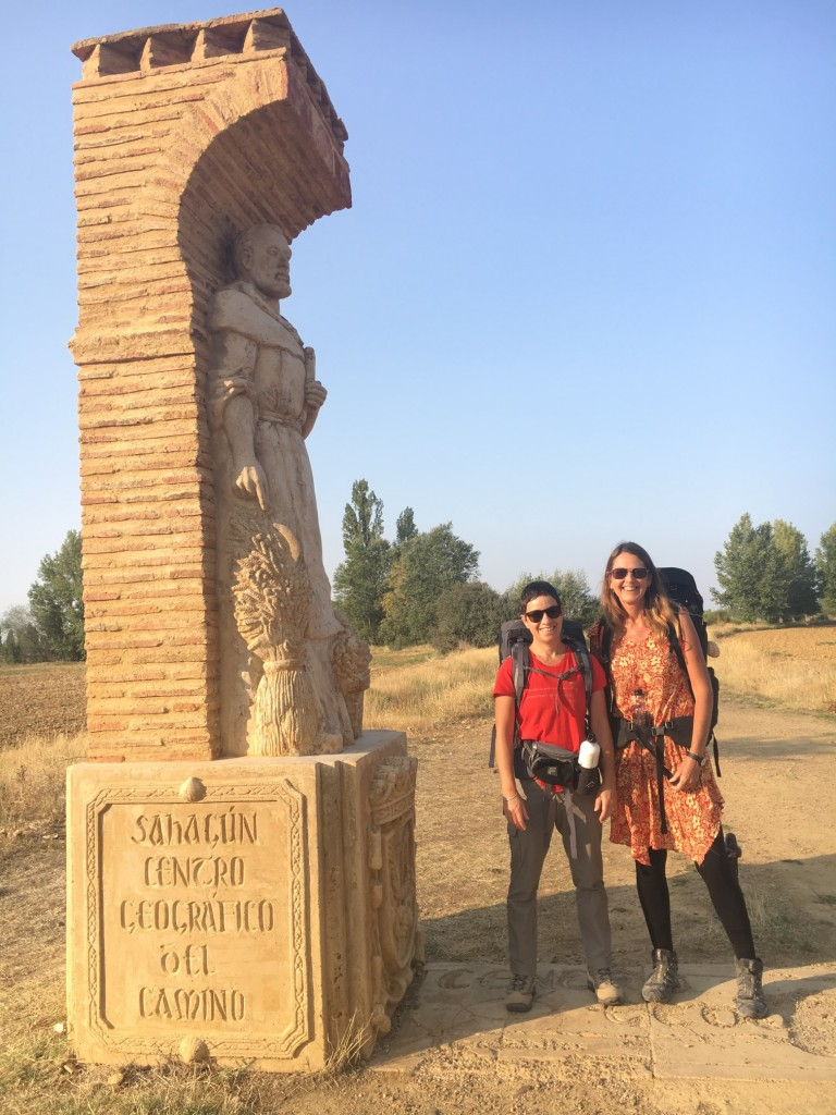 "The sign reads ""Sahagun Centro Geografico o El Camino"". We suspected this was something to do with being halfway. After Sahagun, we had a very isolated, hot and hard walk along an ancient Roman road."