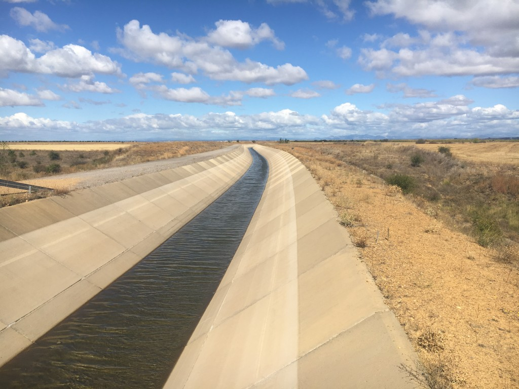 Kilometres of modern concrete canals transporting water to parched fields. The technology hasn't changed for hundreds of years, we saw earlier models of this method as well.