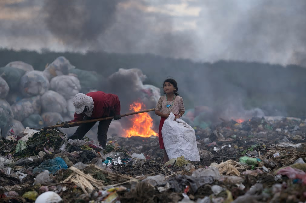 Winner of Ciwem environmental photographer of the year 2017: Quoc Nguyen Linh Vinh for 'The hopeful eyes of the girl making a living by rubbish'