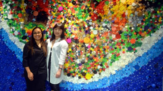 Guest experience supervisor at Kelly Tarlton's Sea Life Aquarium Ebony Lee Dwipayana and Dannemora artist Anne Yang in front of the artwork Our Ocean.