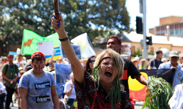 Janine Barratt leading the rally, which began at Martin Place in Sydney, stretched almost 2km. Photograph: Helen Davidson for the Guardian