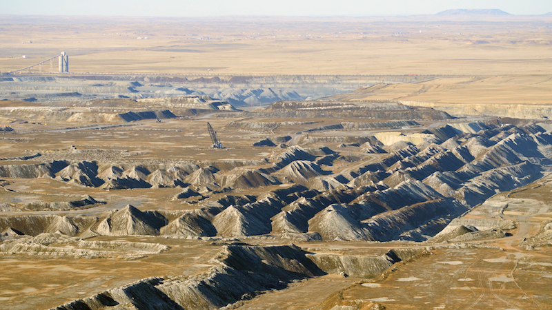 Massive strip mines dig into the coal seams of the Powder River Basin in Wyoming. The basin, which also extends north into Montana, accounts for about 40% of the country's coal production