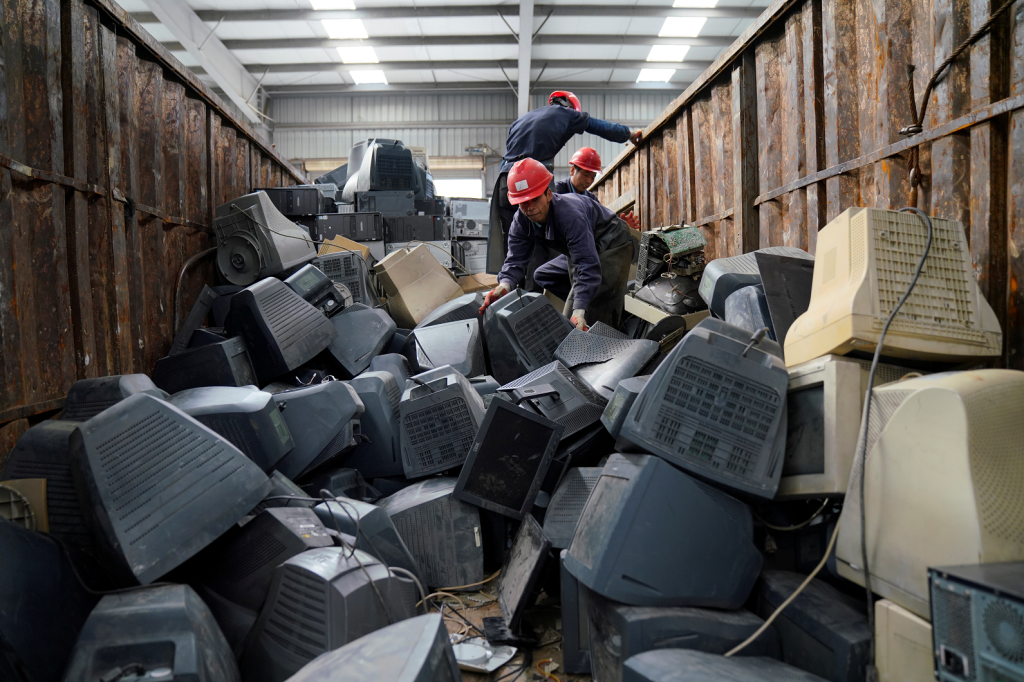 Monitors waiting to be recycled in Guangdong, China.  Image: Reuters/Aly Song