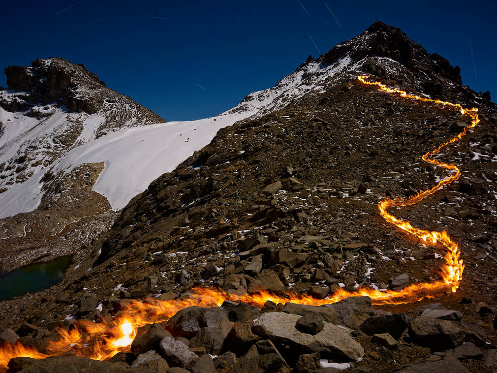 At about 5,000m on Mount Kenya, Simon Norfolk carried a self-made fire torch to create a line of fine showing where the glacier used to extend to  Photograph: Simon Norfolk/Project Pressure