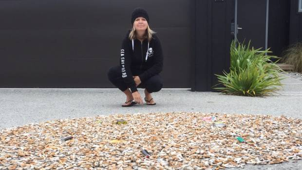 Queenstown woman Liz Smith collected over 10,000 cigarette butts from the own's beaches during 30 days and now wants to see smoking banned in the public areas.