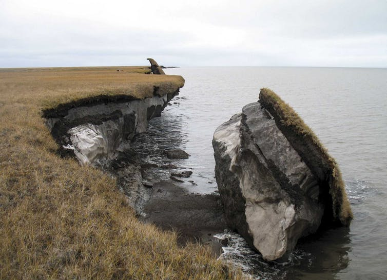Collapsed block of ice-rich permafrost along Drew Point, Alaska, at the edge of the Beaufort Sea. Coastal bluffs in this region can erode 20 meters a year (around 65 feet). USGS