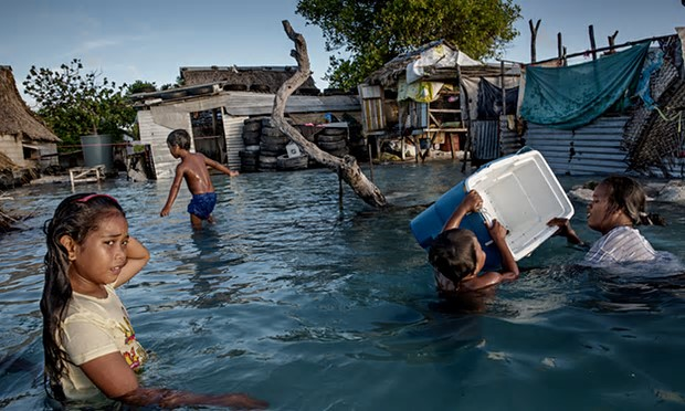 The people of Kiribati are under pressure to relocate due to sea-level rise. Flooding in the village of Eita on the Tarawa atoll is increasingly frequent. Photograph: Jonas Gratzer/LightRocket via Getty Images