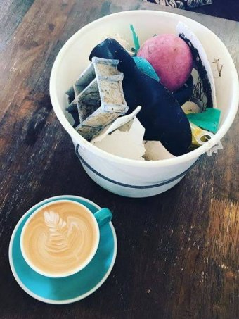 Photo: A bucket's worth of rubbish can be exchanged for a cup of coffee, or a kid's scoop of gelato. (Instagram: intotheblueisland)
