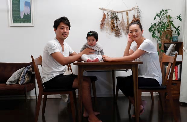 "Eri Sato (right) with her husband Tatsuya and three-month-old daughter, Sara. ""We've switched to reusable bottles and shampoo bars. Our toothbrush is made from bamboo"""