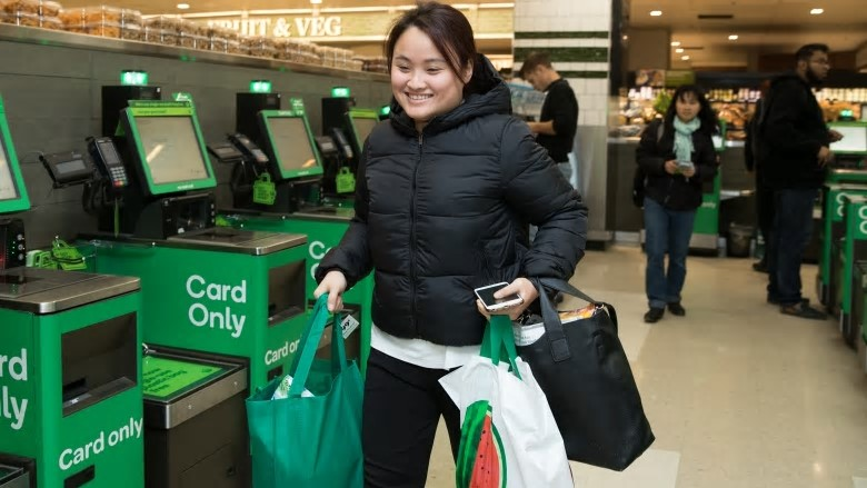 Sylvia Bui, a nursing student, leaving a Woolworths store in central Sydney with her reusable shopping bags on Wednesday. Photo: Janie Barrett