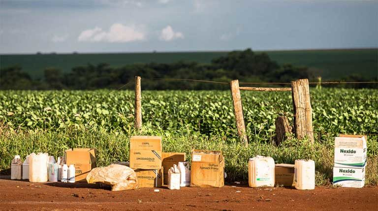 Various agrochemicals to be mixed and applied to the soy crop. Pesticides are rarely applied one at a time, but rather in toxic combinations whose interactions on people and the environment are largely unstudied. Image by Thomas Bauer.