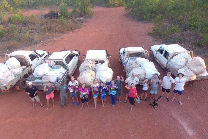 Photo: More than 40 people gathered to clear rubbish from the remote beach. (Supplied: Blue Douglas)