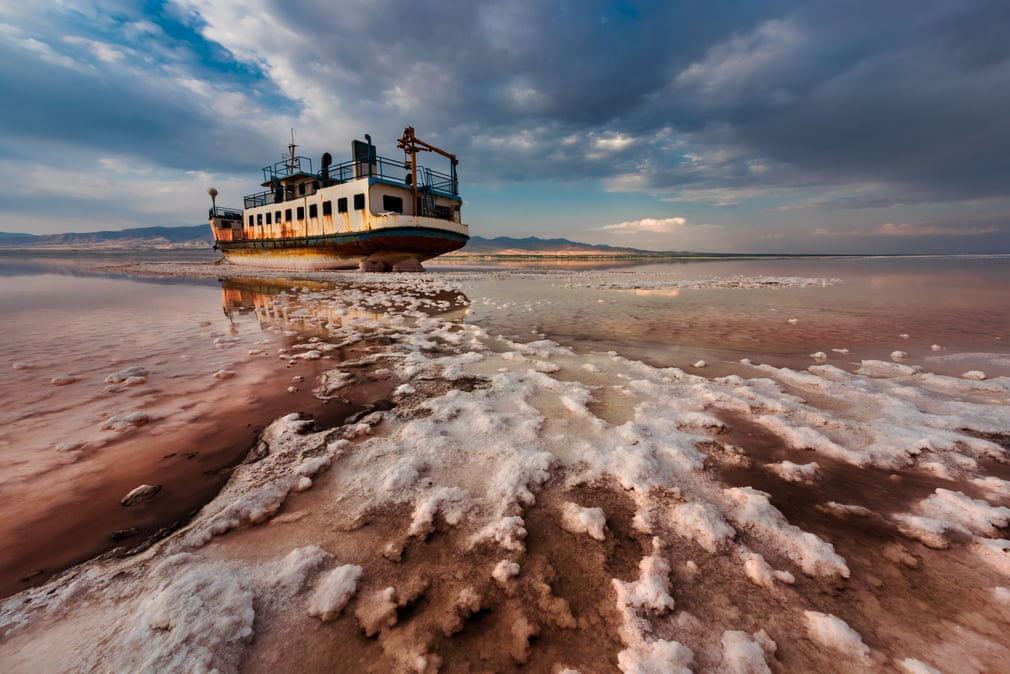 End Floating by Saeed Mohammadzadeh, Iran, winner of the environmental photographer of the year prize 2018. This stunning image shows a ship sitting in salt in the Urmia Lake in Iran. Climate change is intensifying the droughts that speed up evaporation in the country. The lake is also suffering from illegal wells and a proliferation of dams and irrigation projects, causing it to shrink. Noxious, salt-tinged dust storms inflame the eyes, skin, and lungs of residents in surrounding areas. The drying up of the river is also destroying local habitats. With extreme salinity levels of 340g per litre, the lake is more than eight times saltier than ocean water