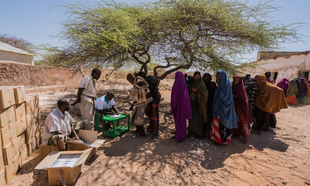 Villagers at a World Food Program aid centre on the outskirts of Mogadishu, Somalia. Many will have walked for days from rural villages looking for food in the nation's capital after severe drought hit crops and livestock, March 2017. Photograph: Giles Clarke/Getty Images