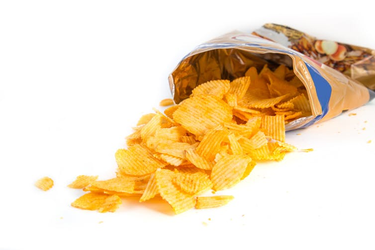 Processed foods promote over-consumption and leave packaging behind. from www.shutterstock.com