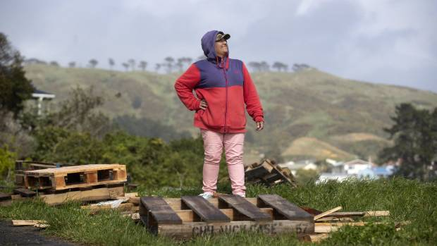 Daphne Swinton at a public drop-off point, known locally as Pallet Mountain, along Bedford St in Cannons Creek, Porirua. Photo: Monique Ford/Stuff