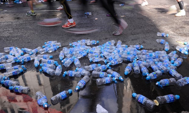 Masses of discarded water bottles during the London Marathon. Photograph: Tom Jenkins for the Guardian