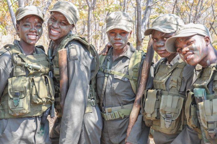 "Photo: Survivors of domestic abuse, widows and single mothers — Akashinga women have ""been through hell"". (Supplied: International Anti-Poaching Foundation)"
