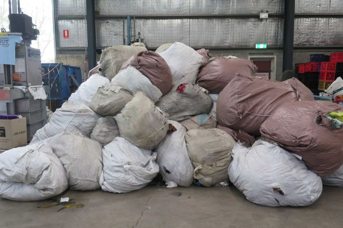 Photo: Textiles donated to Australian charities are often destined for landfill. (ABC News: Amy Bainbridge)