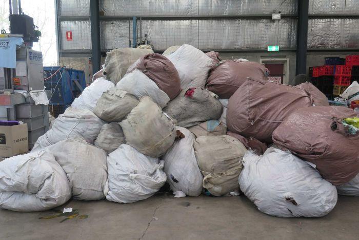 Photo: Textiles donated to Australian charities are often destined for landfill. (ABC News: Amy Bainbridge)