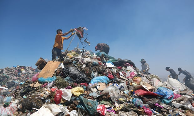 Men search through pieces suitable for recycling at the municipal garbage dump in Diyarbakir, Turkey. Photograph: Sertac Kayar/Reuters