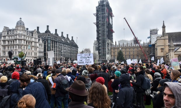 An estimated 1,000 protesters gathered on the green in Parliament Square. Photograph: Matthew Chattle/Barcroft Images
