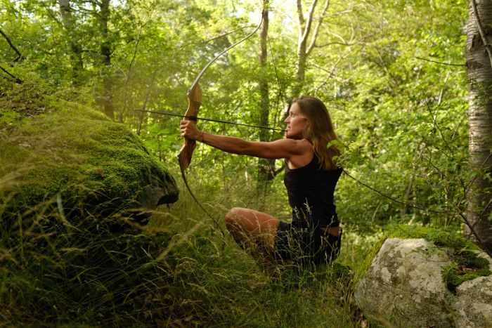 Photo: Miriam perfected her aim with a bow and arrow, but finding animals to hunt proved tricky. (Supplied)
