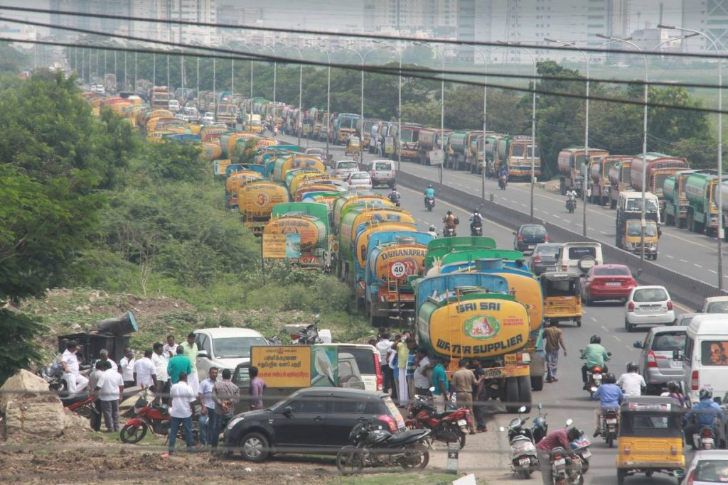 Water lorries park along the Old Madras road during a three-day strike in Chennai, India, October 1, 2018. Thomson Reuters Foundation/Sanjay Kishore