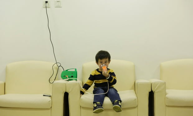 Hanhan, three, receives nebuliser therapy after a Beijing red alert for air pollution in 2015. Photograph: Jason Lee/Reuters